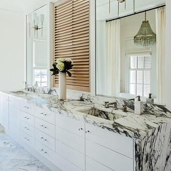 white and black marble waterfall countertop on bath vanity