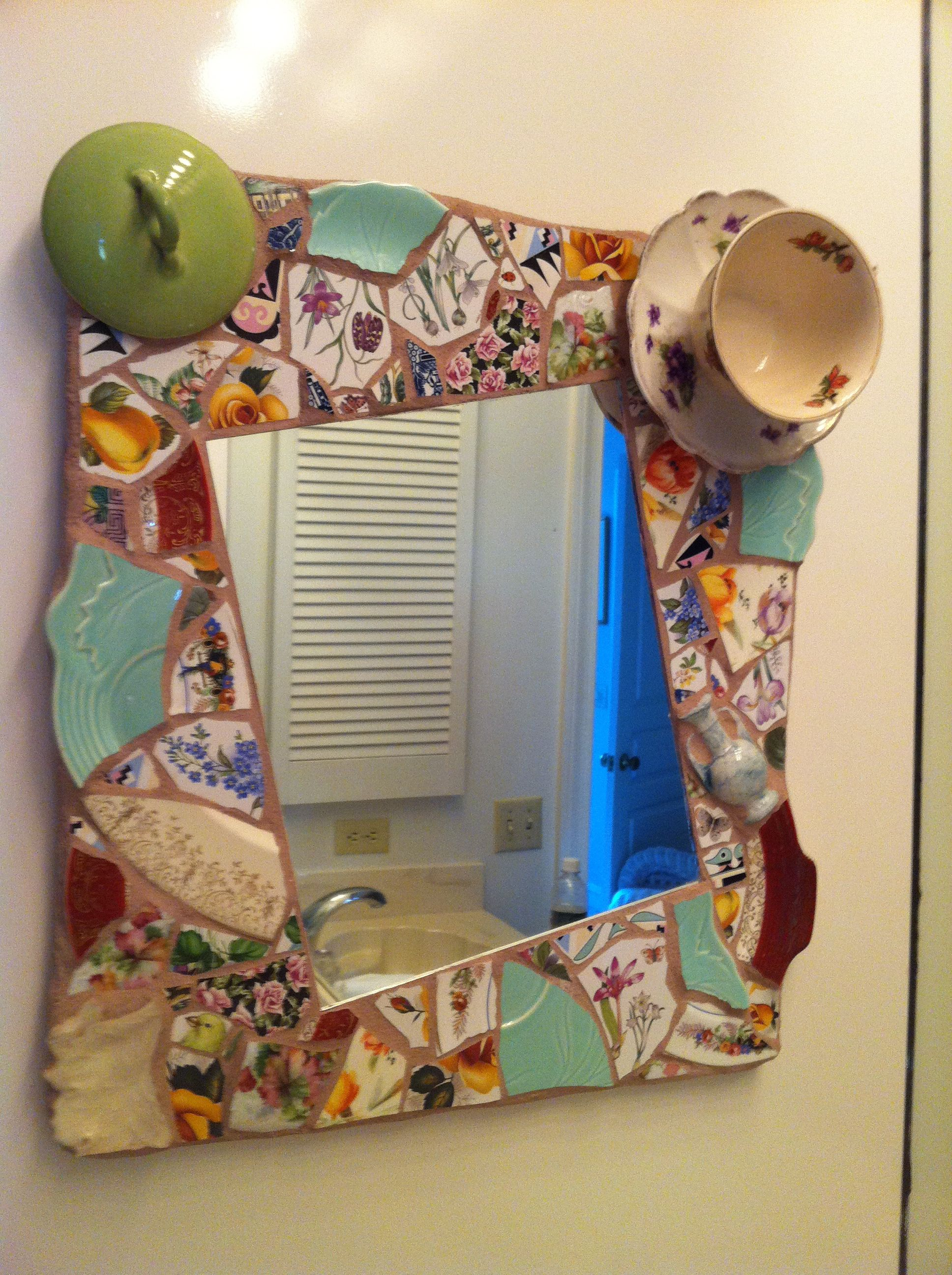 Broken dishes and an entire cup and saucer frame a mirror