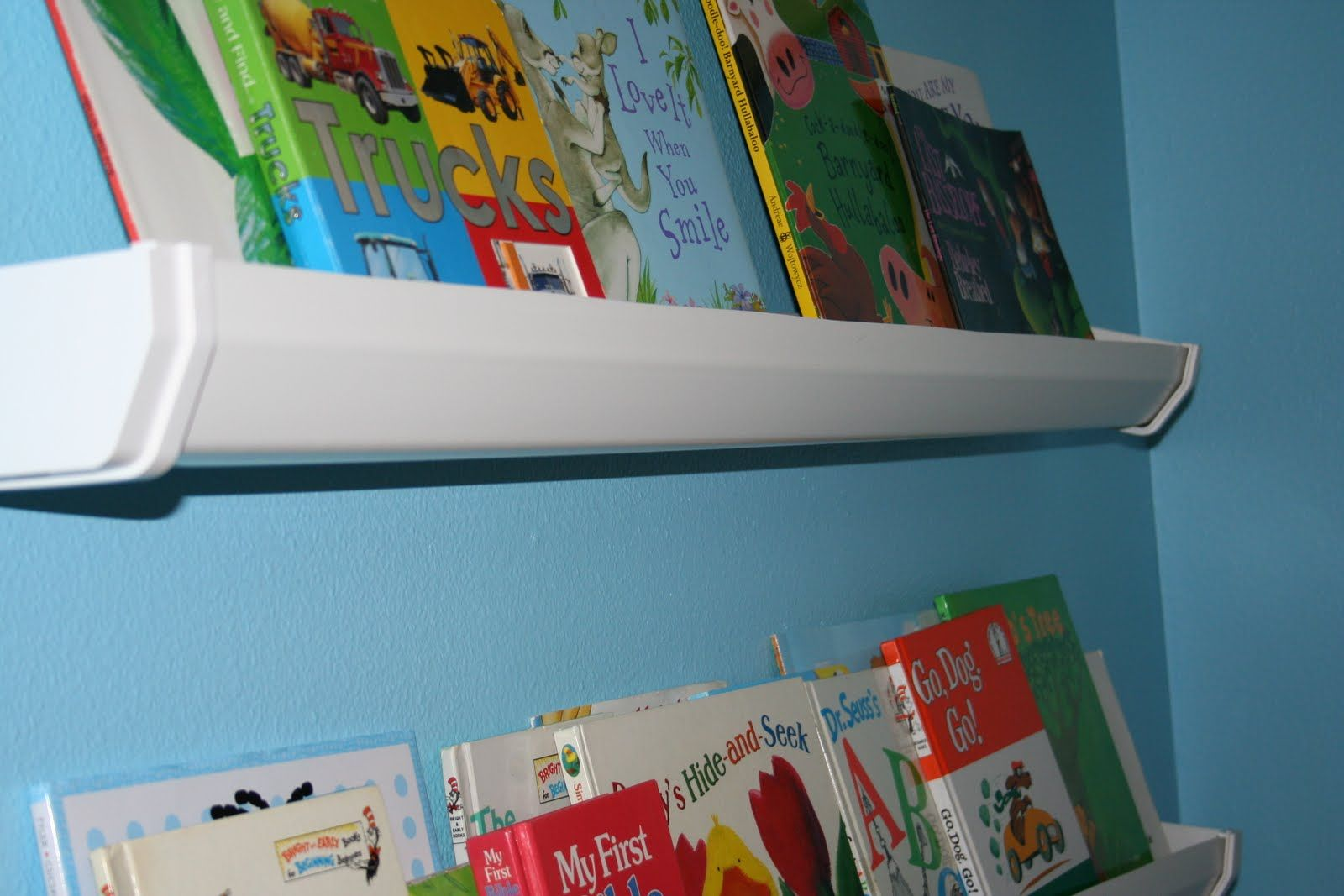 Wall Mounted Bookshelves Made From Vinyl Gutters Awesome