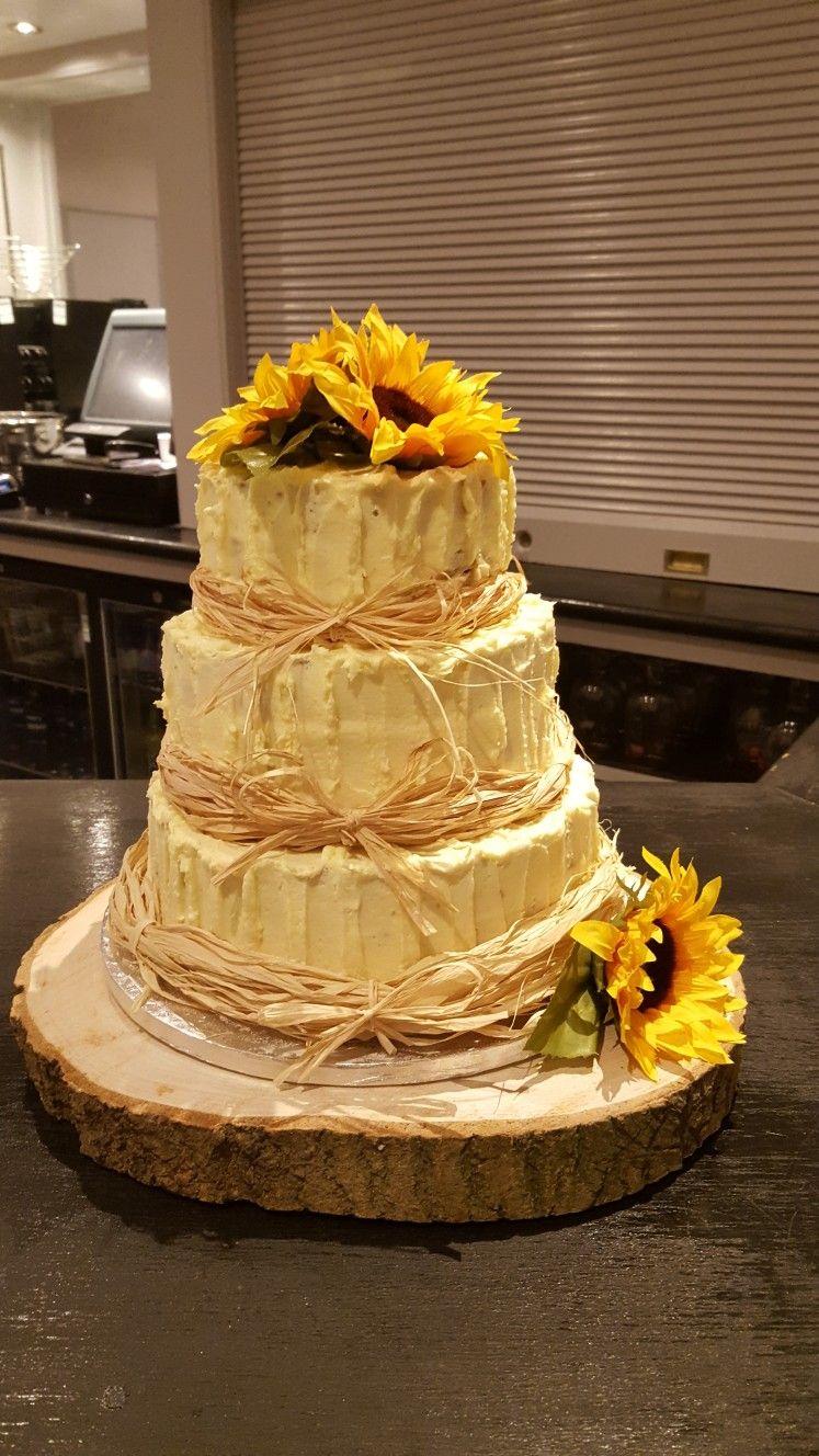 3 tier vintage wedding cake buttericing raffia bows