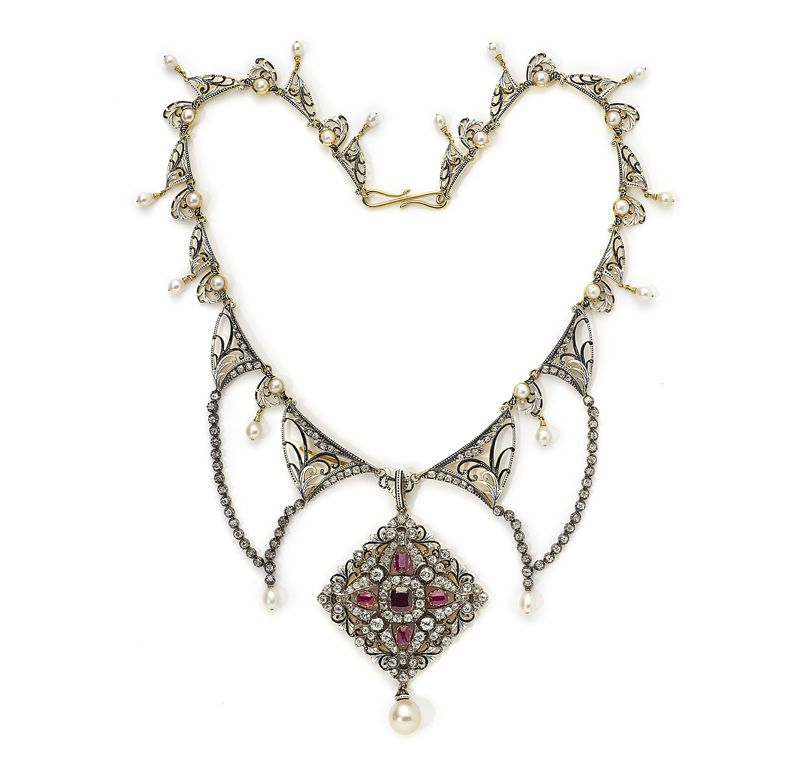 A jewelled and enamelled gold necklace  by Carlo & Arthur Giuliano     in the renaissance taste, the lozenge shaped pendant set with diamonds and rubies and hung  with a pearl, suspended from an openwork necklace mounted with pearls and diamonds  and enamelled black and white in the manner of the English sixteenth century.    Contained in its original silk and velvet lined fitted leather case.    London circa 1890    Pendant 6.6cm
