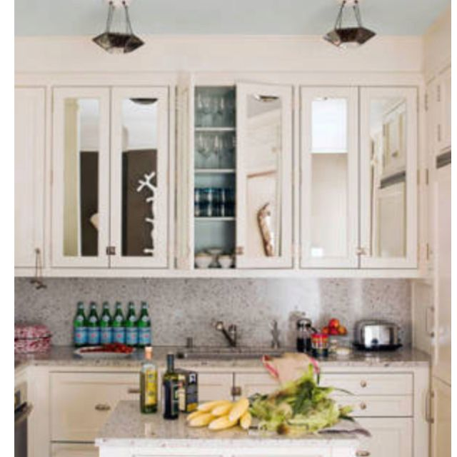 High End White Kitchen: Cabinets With Mirrors On The Doors. Very Traditional