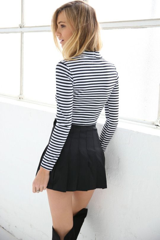Sexy Skirts Shapely Girl Sporting A Pleated Mini Skirt
