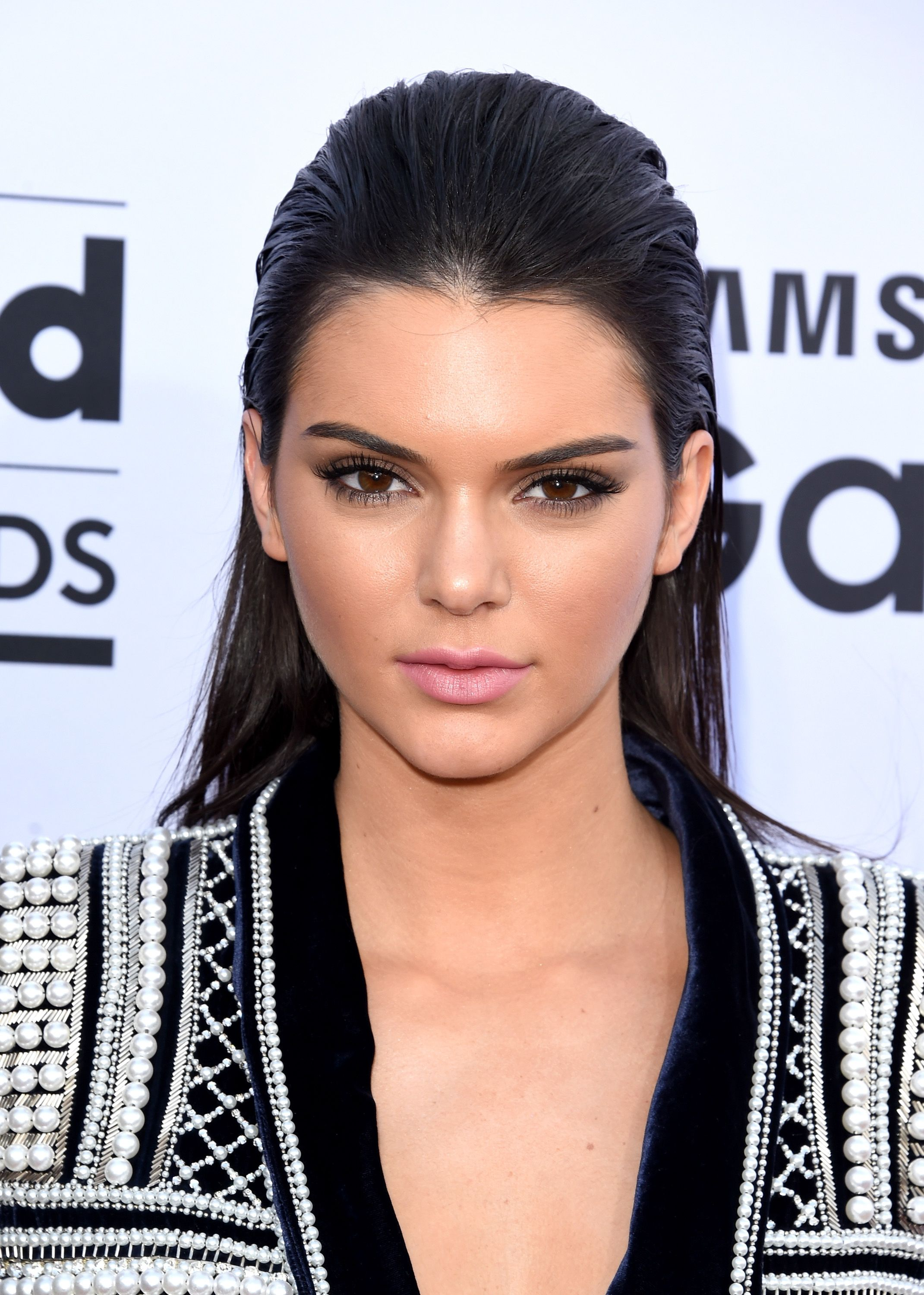 Channel Kendal Jenner with a chic, slicked back hairstyle ...