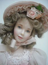 "Franklin Mint's ""Dainty Bess""  porcelain and cloth doll designed by Bernice Mowry, circa 1999."