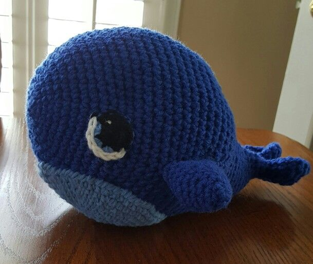 Whale pattern purchased from One and Two Company. I crocheted eyes instead of…