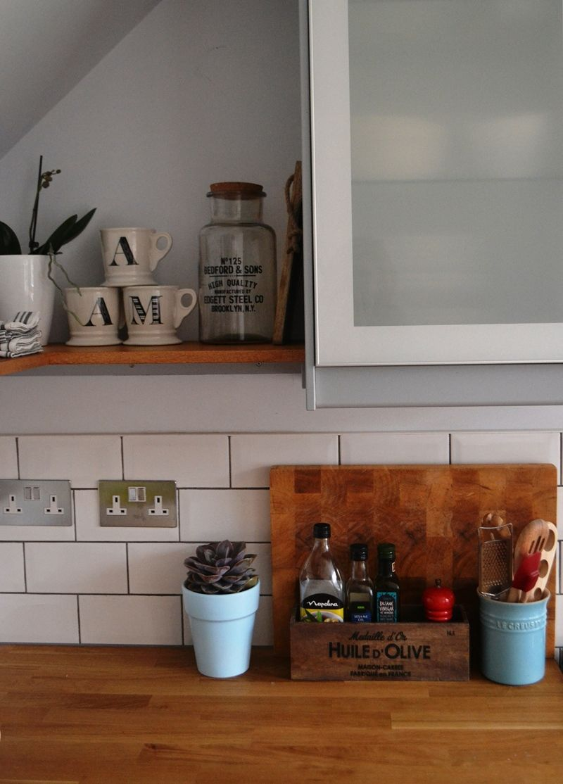 we've added open wood shelves to our kitchen which has ikea veddinge
