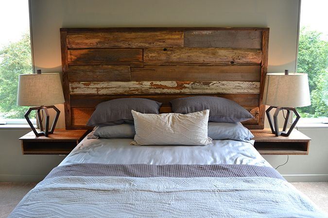 This headboard creates a dramatic piece made of salvaged wood. I really  like how it frames the mattress generously. By Madera Furniture Company - Tree Slab Headboard - Google Search Cabin Bedrooms Pinterest