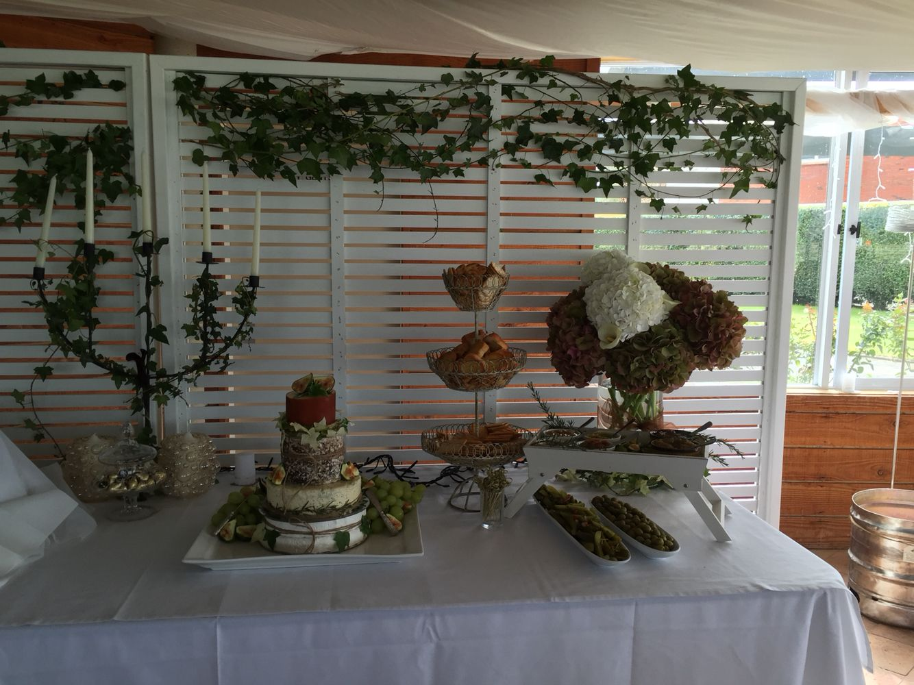 Cheese wheel, snacking area for wedding.