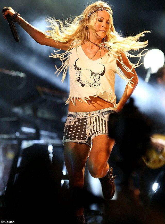 She loves her country! Carrie Underwood wears a pair of ...