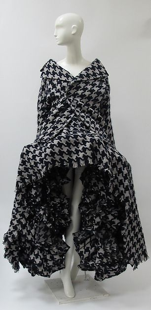 Ensemble Designer: Yohji Yamamoto (Japanese, born Yokohama, 1943) Date: fall/winter 2003–4 Culture: Japanese Medium: wool Dimensions: Length at CB (a): 34 in. (86.4 cm) Width (b): 59 in. (149.9 cm)