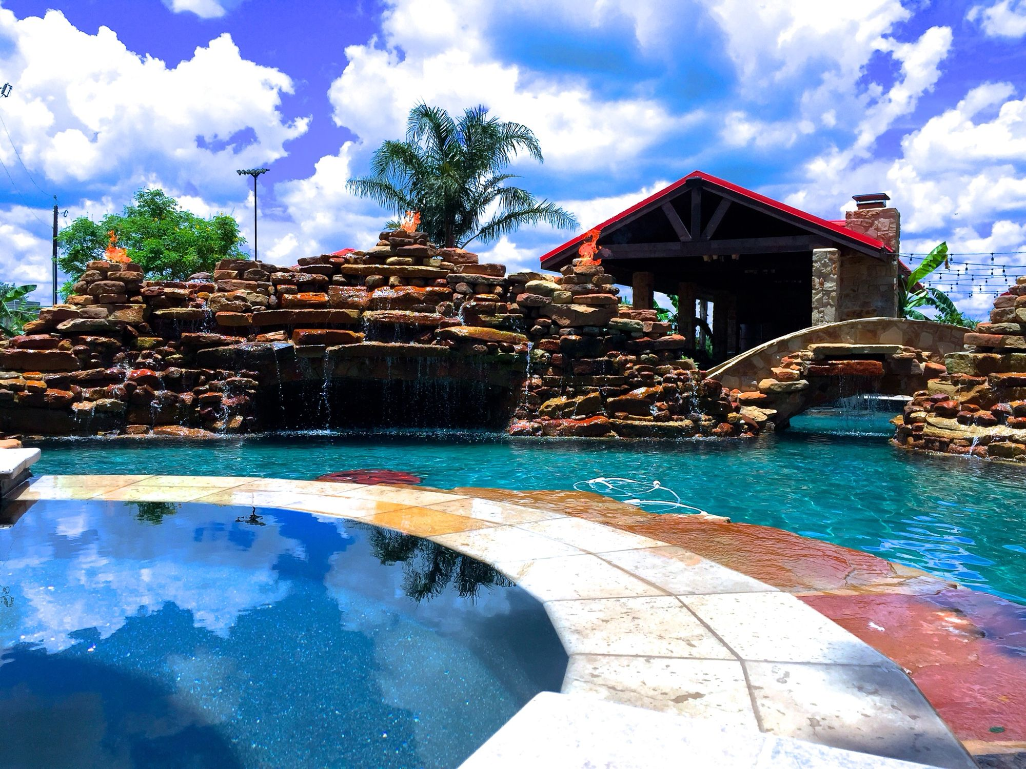Custom pool with grotto and water/ fire features just south of San Antonio