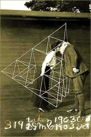 Alexander Graham Bell kissing his wife through a tetrahedron.