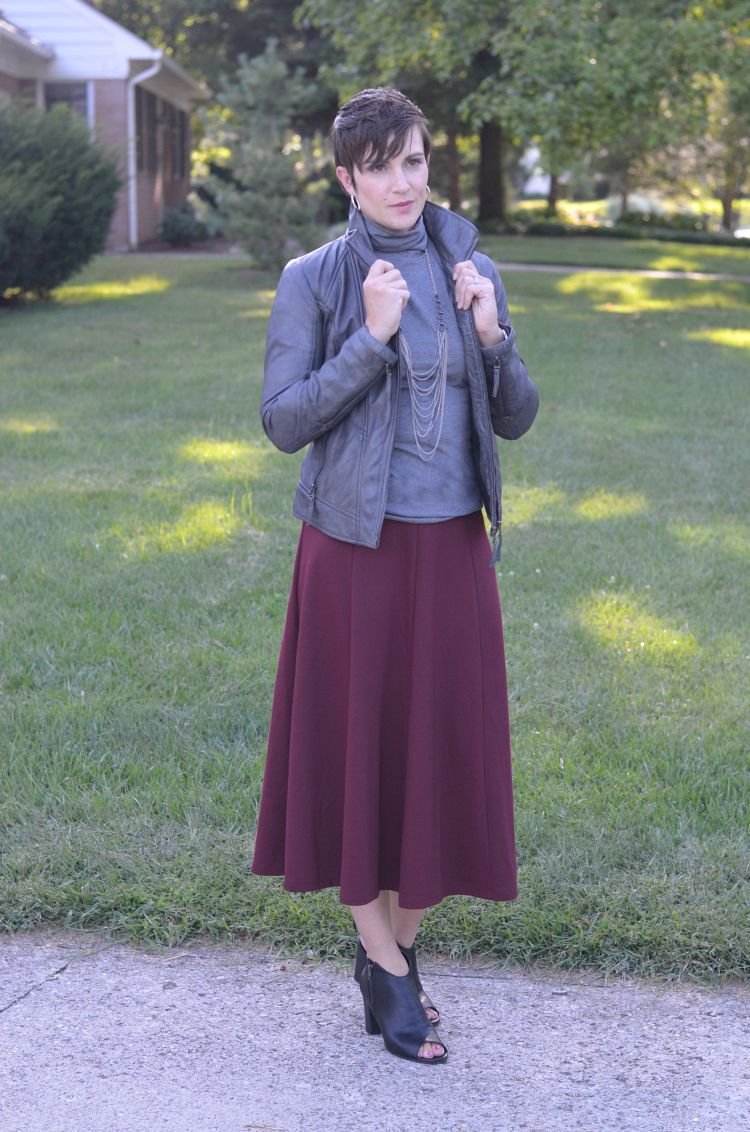 3 ways to wear a midi skirt for fall add a leather
