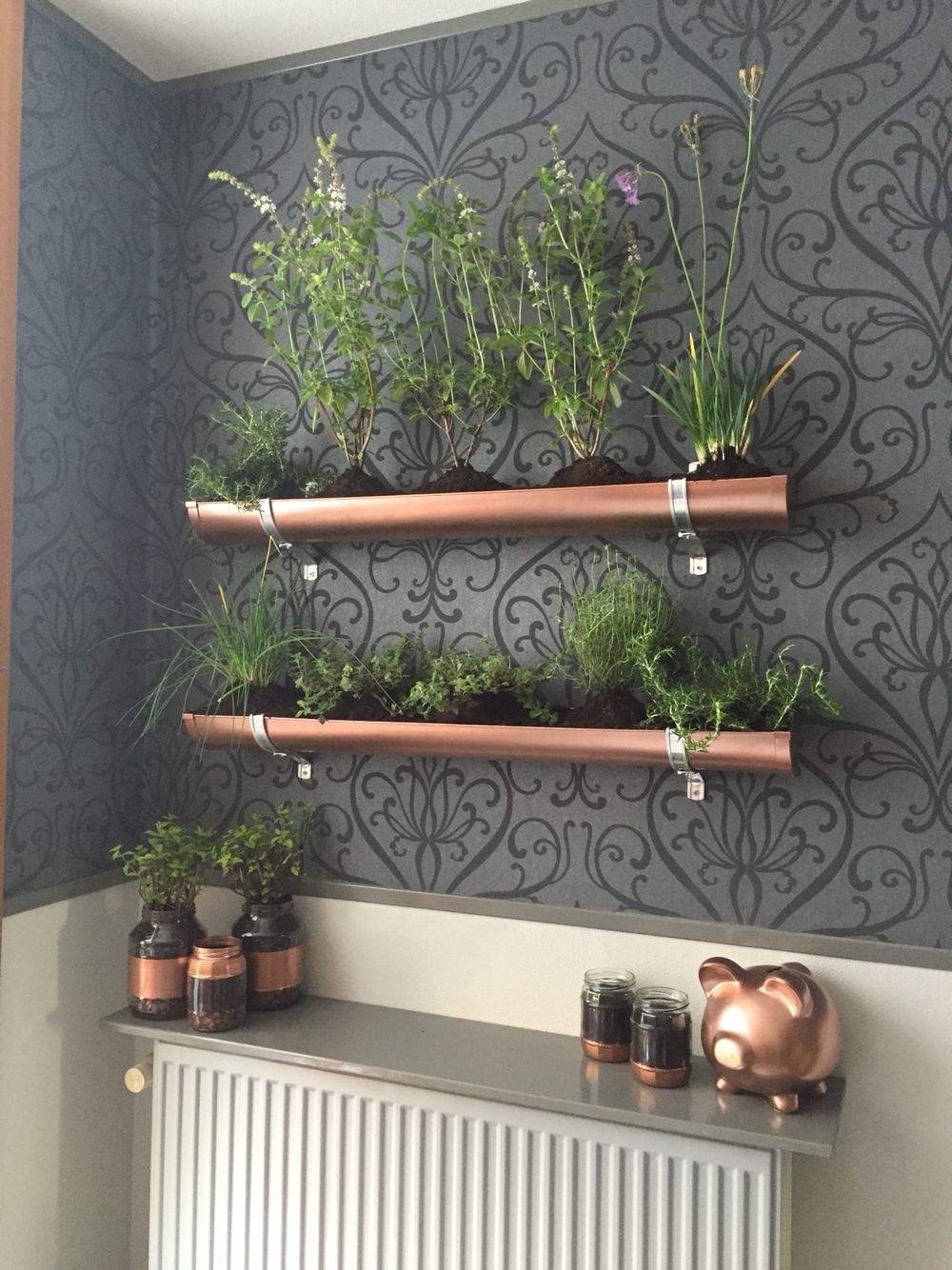 Indoor vertical herb garden pvc gutter and copper spray paint to give it a steampunk ish look old pickle jars and spray paint equals cool planters