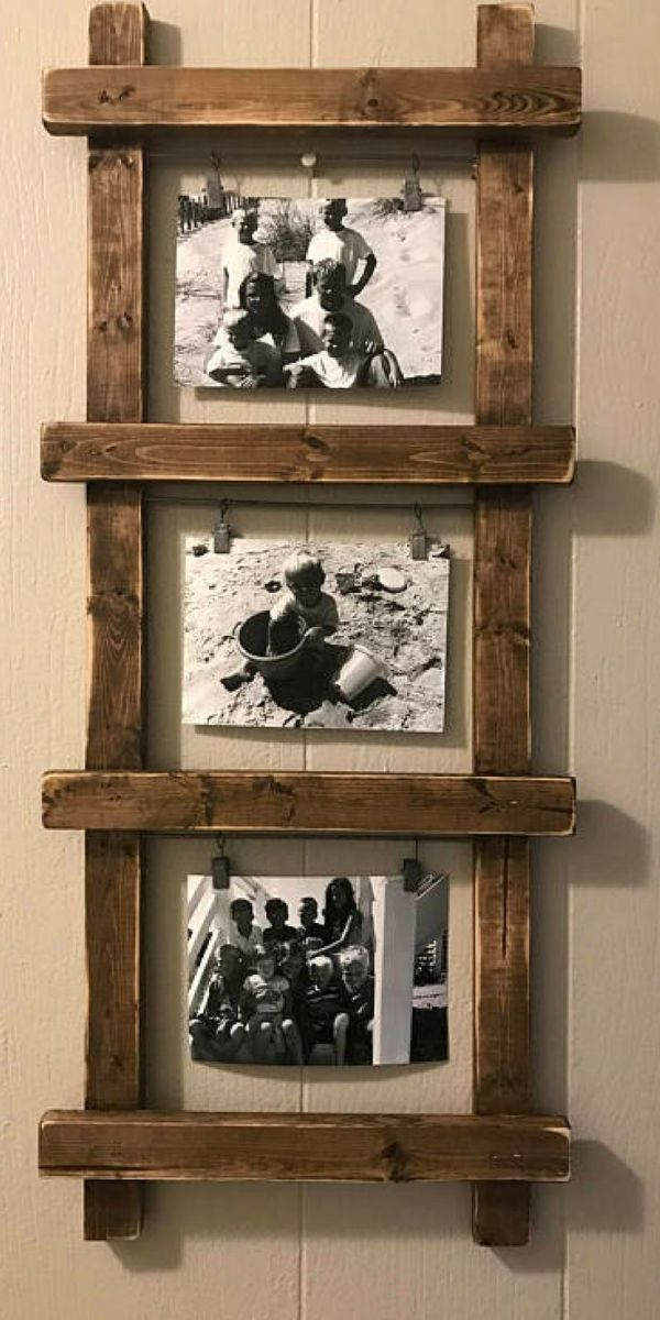 rustic photo holder, ladder photo holder, ladder decor, rustic decor, farmhouse decor, unique photo holder, photo display, nursery decor #ad #homedecor #farmhouse #farmhousedecor #rusticdecor #DIYhomedecor #professionalpinner by esmeralda #setinstains