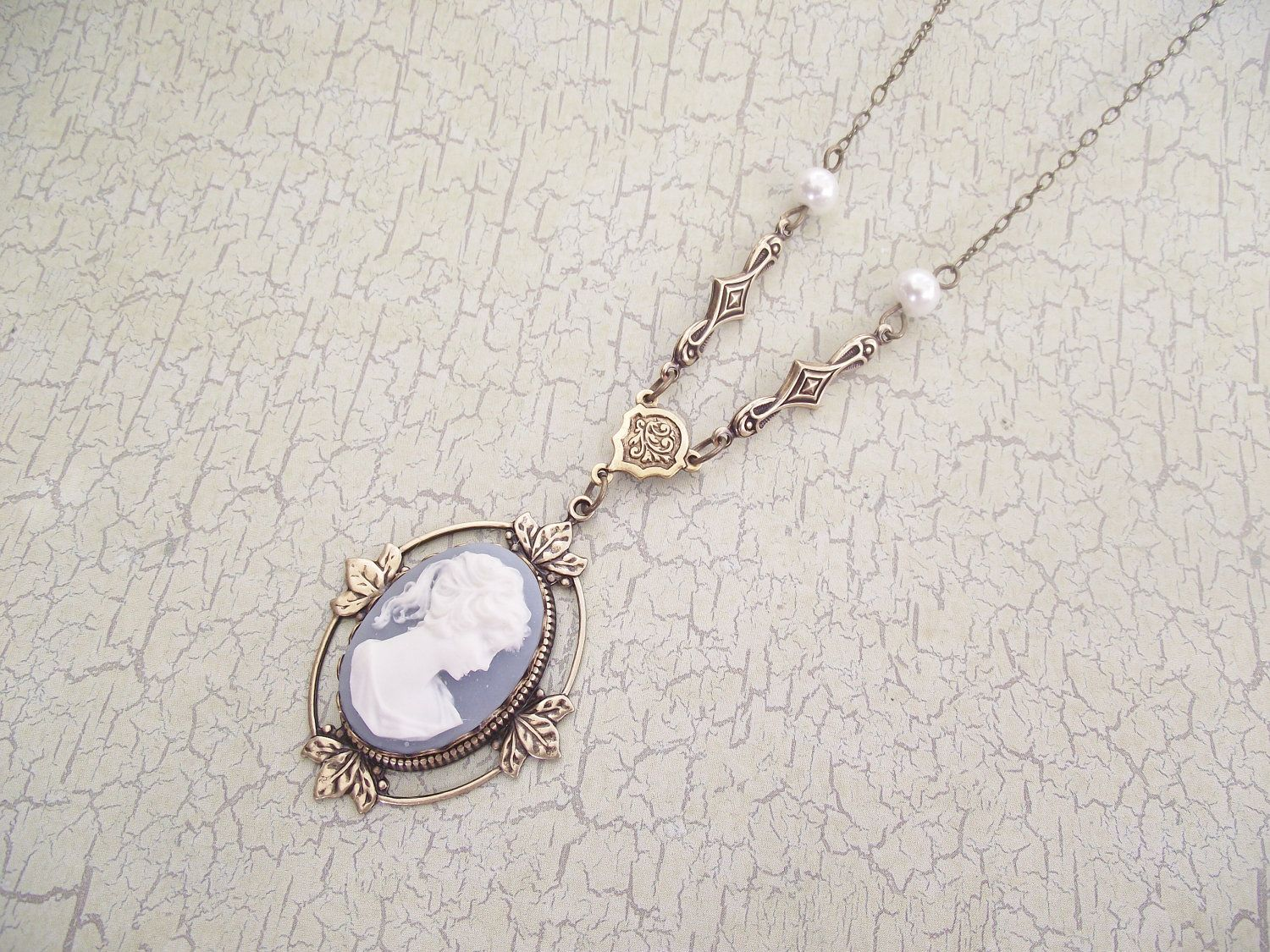 NEW YEARS SALE - Katherine - A Cameo Necklace in Antique Brass and Antique Gold. $29.99, via Etsy.