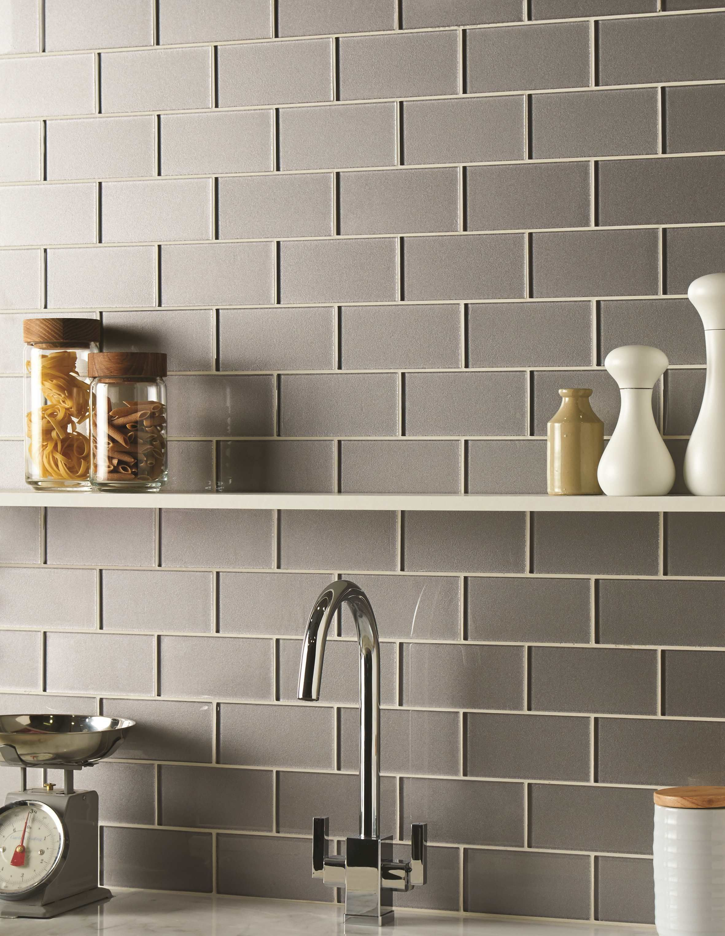 Erebos metallic glass brick tiles are a modern twist on a for Kitchen wall tile