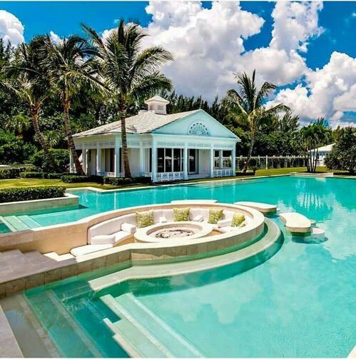 Luxury Mansions With Swimming Pools: Fire Pit And Seating Inside The Swimming Pool.