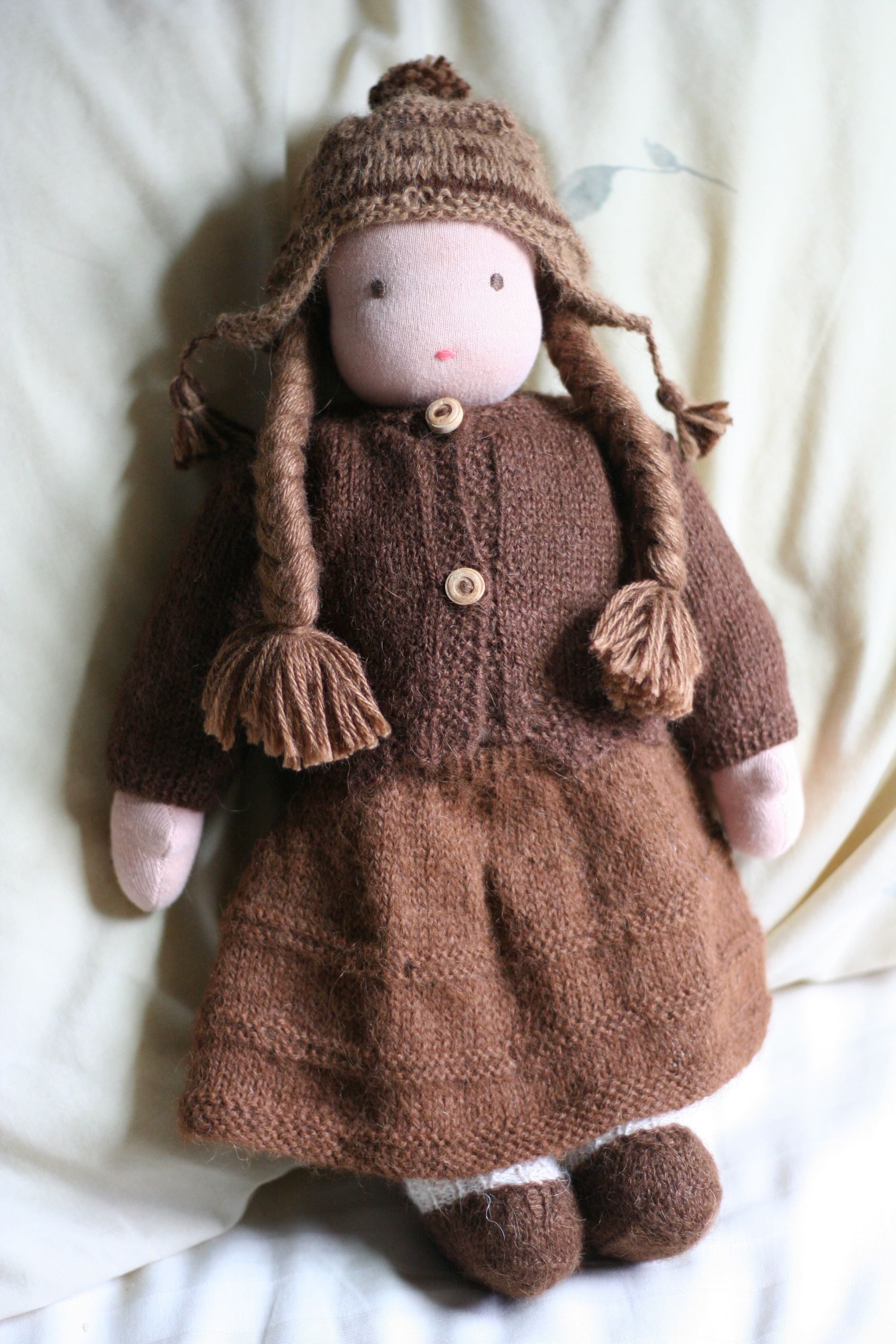Waldorf Doll; brown knit dress and sweater, brown earflap ...