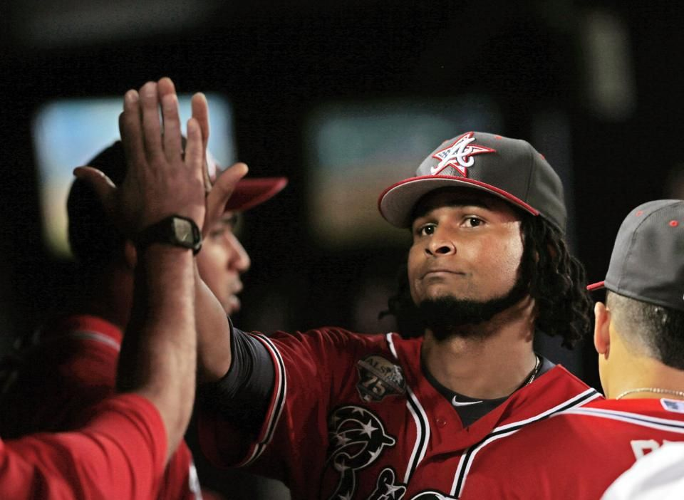 Atlanta Braves starting pitcher Ervin Santana is greeted by teammates after getting relieved during the eight inning of a baseball game against the Arizona Diamondbacks .