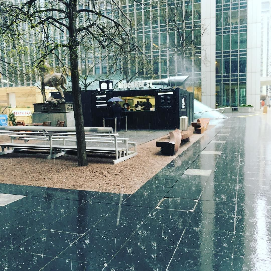 Sheltering waiting for a @bleeckerburger in the pouring rain in the Wharf. #rain #london #canarywharf #bleeckerstreet #betterbeworthit #Friday #burger by sijkelly