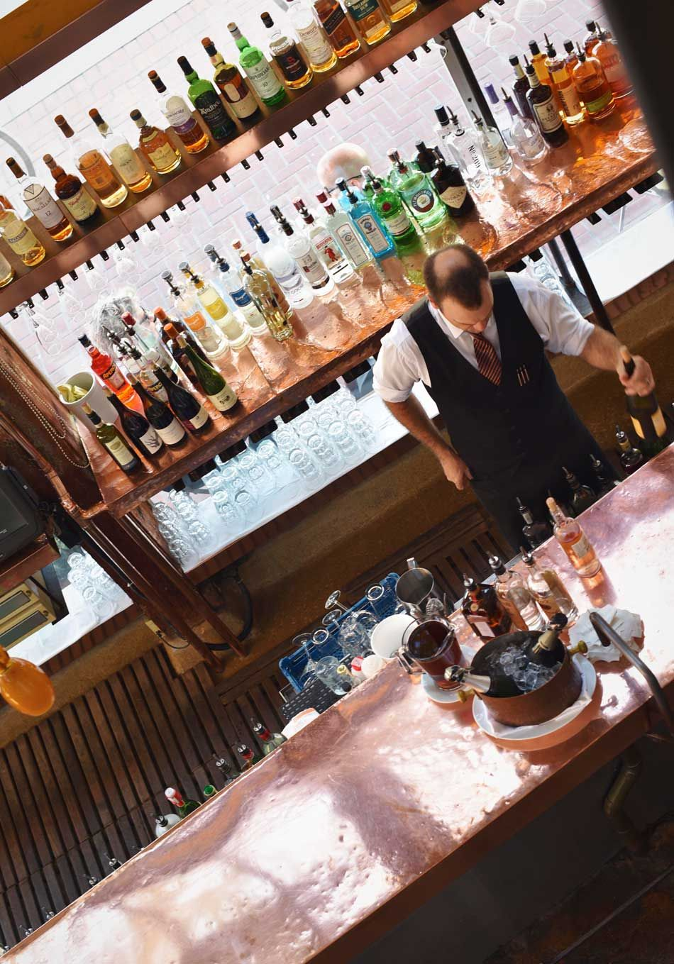 The bar is a colorful spotlight that passersby on