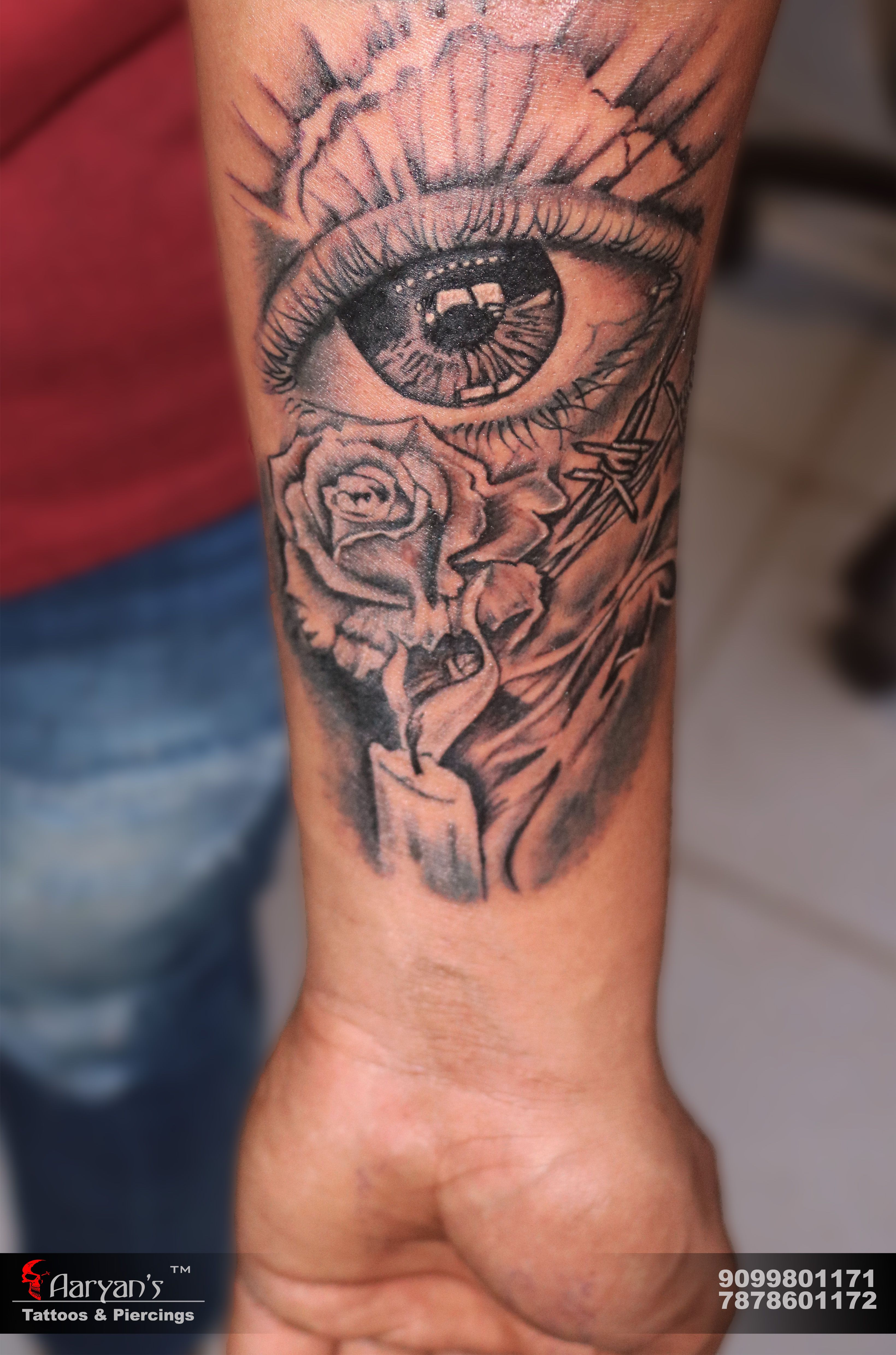 Realistic eye with rose and candle tattoo realistic rose