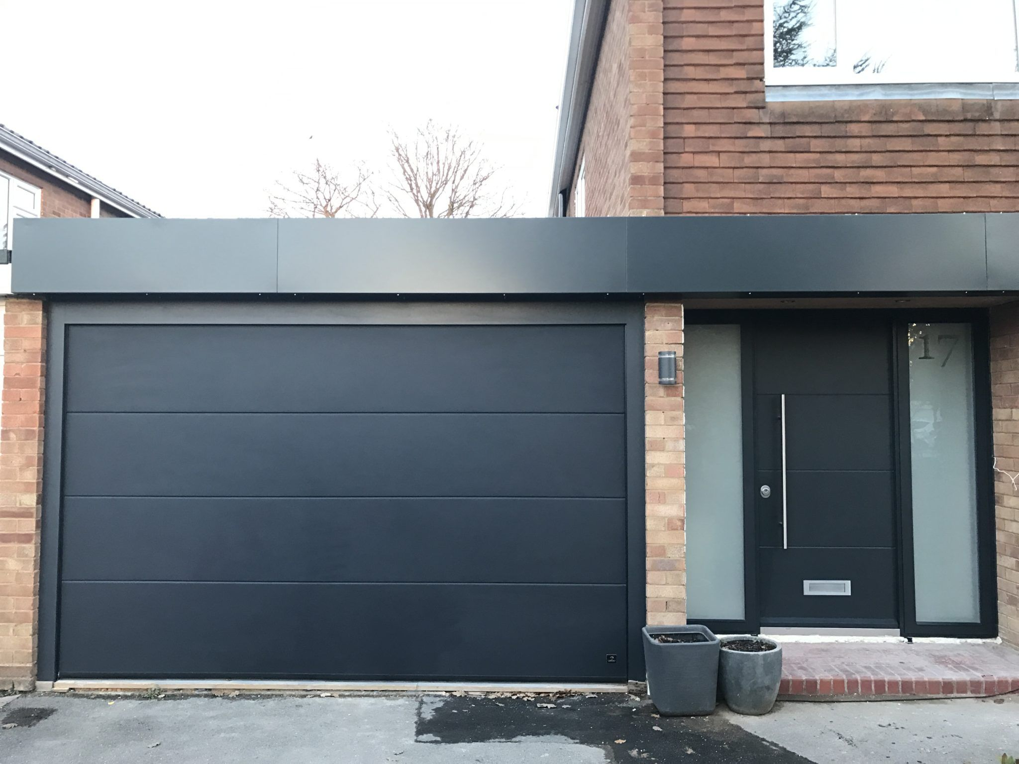 Doors With A Personal Touch Matching Design Entrance Garage Doors From One Manufacturer Garagedoors Entr Garage Door Design Garage Doors Garage Door Styles