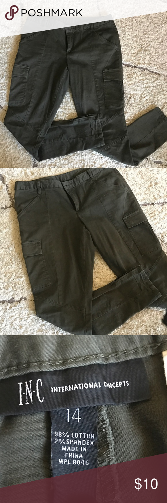 slim cut cargo pants Great slim cut cargo style pants with fun zipper detail at the ankles. Features flap back pockets and a moto detail below knee. In great condition only worn a handful of times. I.N.C Pants