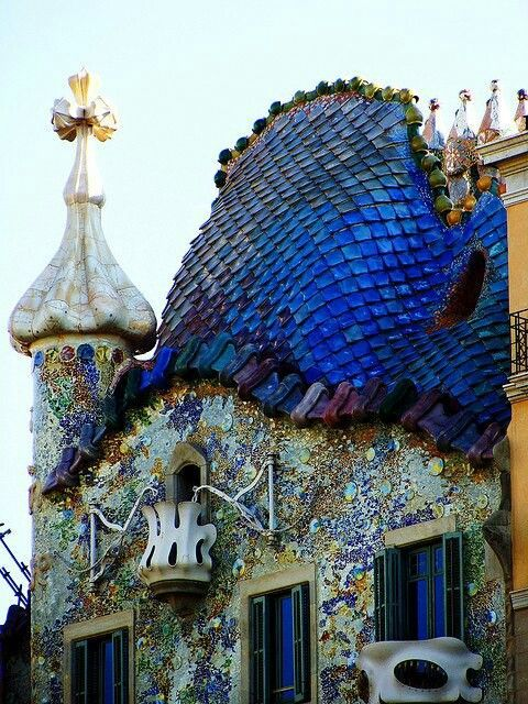 Gaudi architecture. Beautiful fish scale roof tiles ...