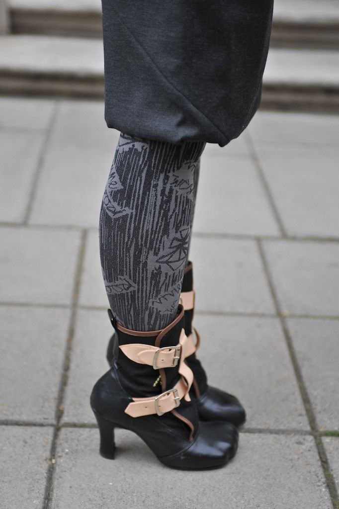 Vivienne Westwood boots and leggings at London Fashion Week .