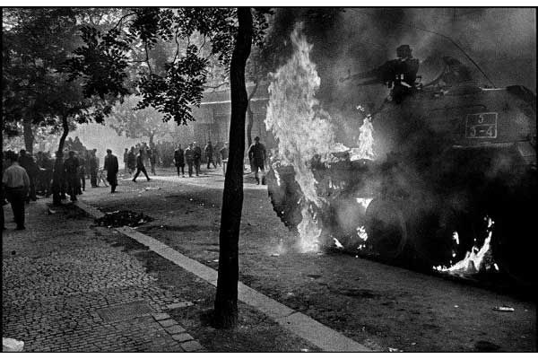 PRAGUE INVASION, 1968 - Much of the resistance was centered around the Prague radio station. As the day progressed, Czechoslovak youths threw home-made missiles and even tried to take on Soviet tanks.  ~  (Photo by Josef Koudelka.)