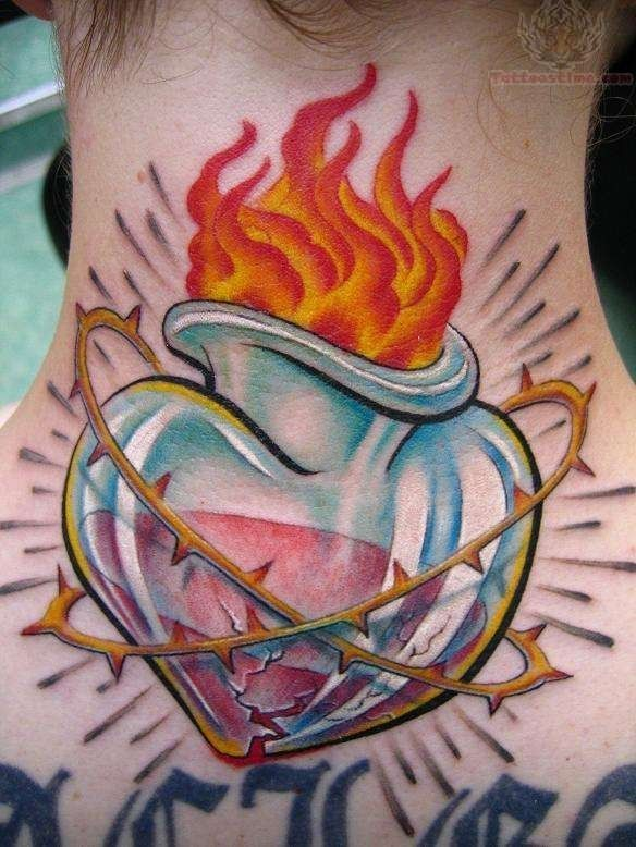 Burning Sacred Heart Tattoo On Back Neck