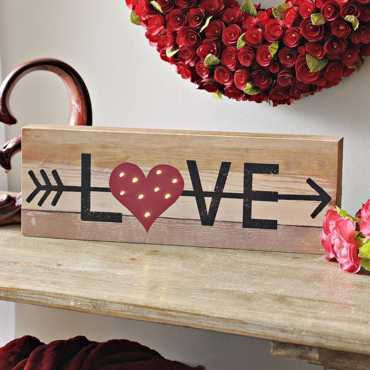 PreLit Wooden Love Sign - Valentine wood crafts, Valentines sign, Valentines day decorations, Valentine day crafts, Valentines diy, Diy easter decorations - Let love light up your life with this PreLit Wooden Love Sign  Its wood plank design and small, LED lights give this tabletop sign plenty of vintage charm             Sign measures 19 75L x 1 5W x 7H in           Crafted of wood composite          Wood plank design features the word  Love  and an arrow design          Heart prelit with small, LED lights          Tabletop display          Requires two (2) AA batteries; batteries not included          Care Dust with a soft, dry cloth           This item is available at Kirklands com only, not available in stores