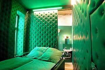 From top to bottom and all around the bed, everything is upholstered with green leather. A kingly or queenly room where one can hear his own heart beat when the spirit grows weary. Small but exquisite, and undeniably noble on top of that!