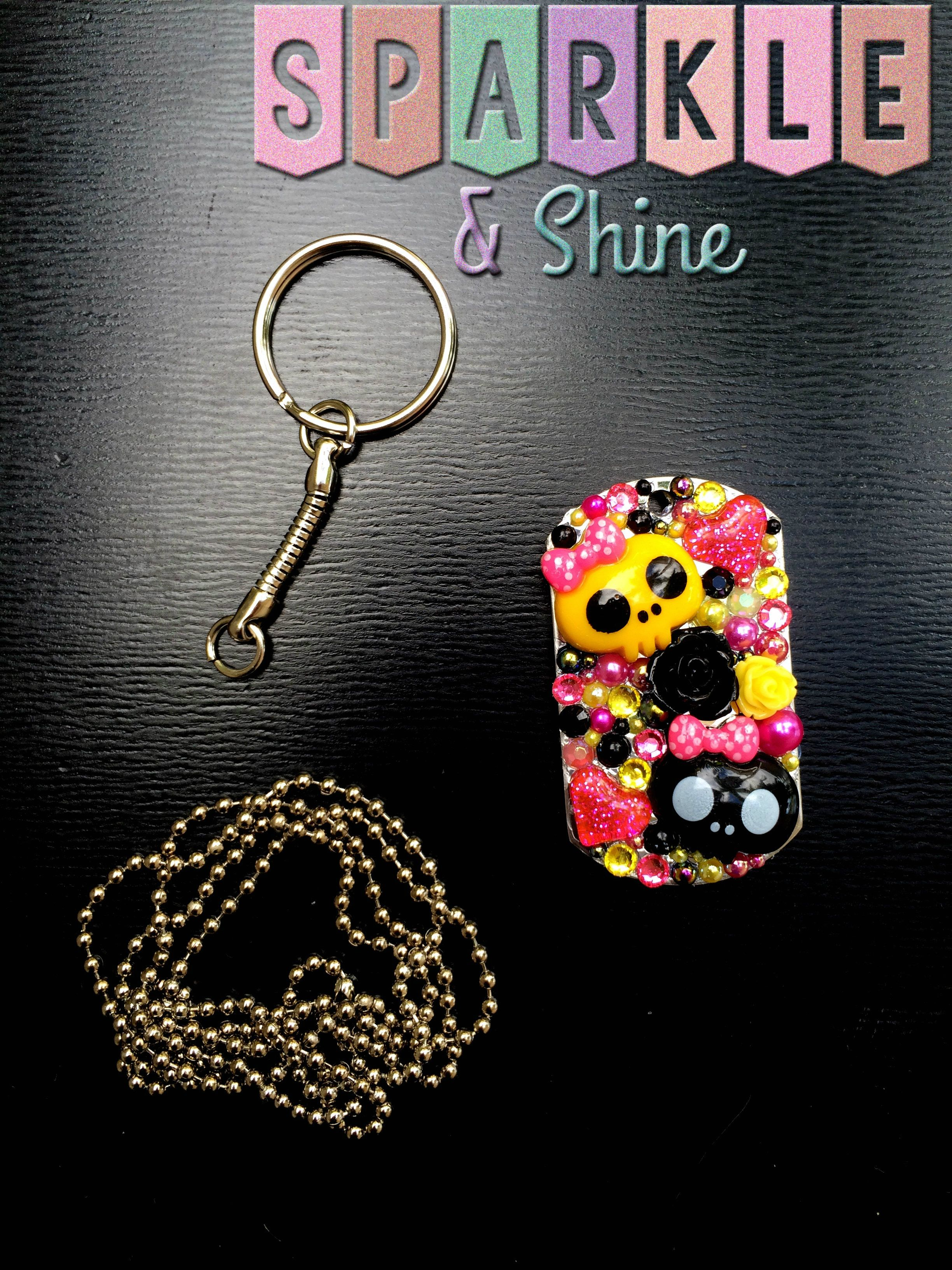 """Add a bit of adorable goth glam to your keys with these sour black&yellow colored skullies!   Dog tags are available on a 30"""" ball chain necklace, or on a keychain.   Unless otherwise pictured all dog tags have a fully blinged back.  (Any overcharges for shipping will be refunded once your ..."""
