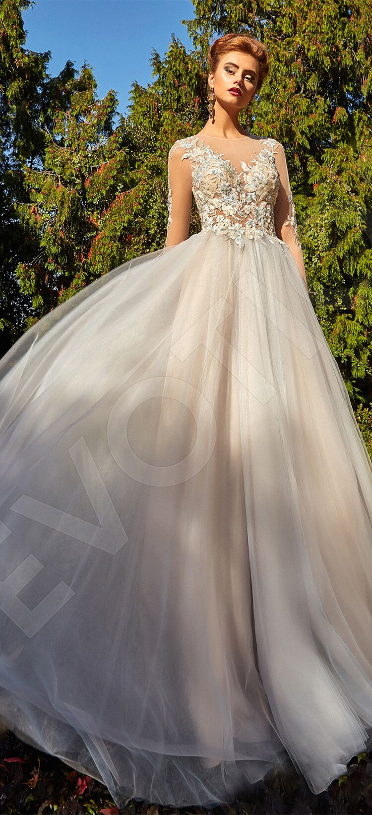 Acut cream wedding dress is made out of satin tulle and spanish