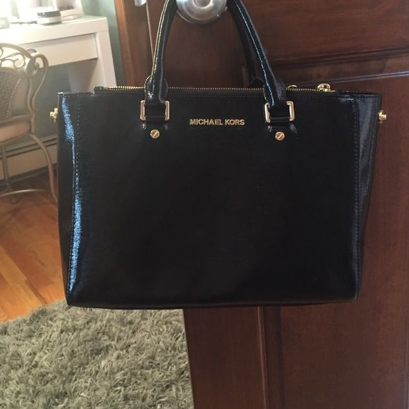 I used it a few times,but I do not want it anymore Black and gold Michael Kors bag. It has many pockets and double sided zippers for storage as well. I purchased it last year so it is fairly new. It is in great condition. Michael Kors Bags Mini Bags