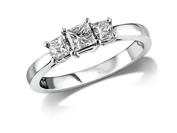 Platinum set three stone diamond engagement ring, with a certificated brilliant cut centre in a four claw setting, and one brilliant cut with diamond set shoulders on each side. Perfect fit with a wedding ring. Total diamond weight: 0.52ct  A 0.30ct centre, Princess, G, Three stone diamond ring. You can reserve online and view in store at Michael Jones Jeweller, Northampton