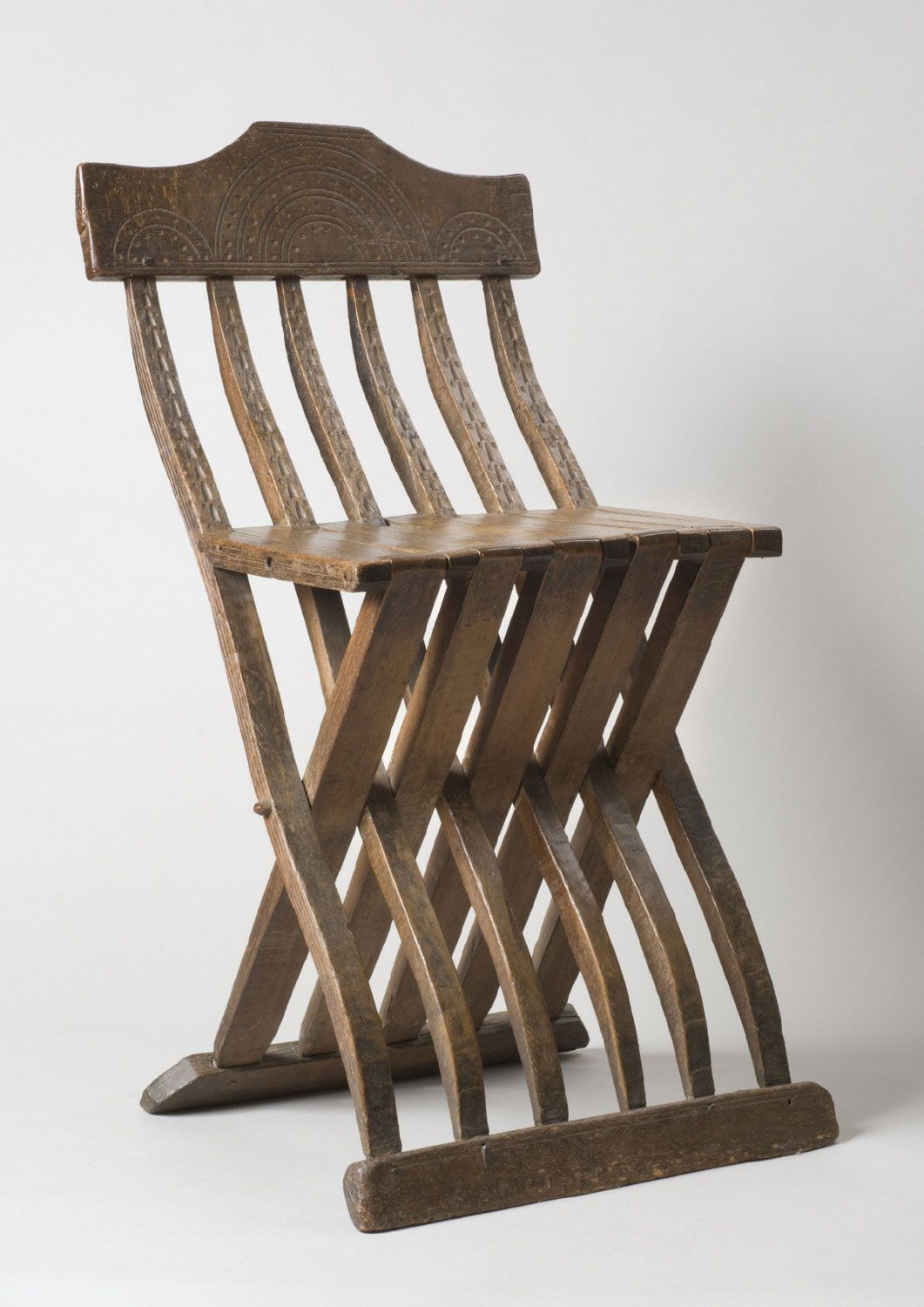 FOLDING CHAIR. Italian maker; beechwood; dimensions 31 1/2