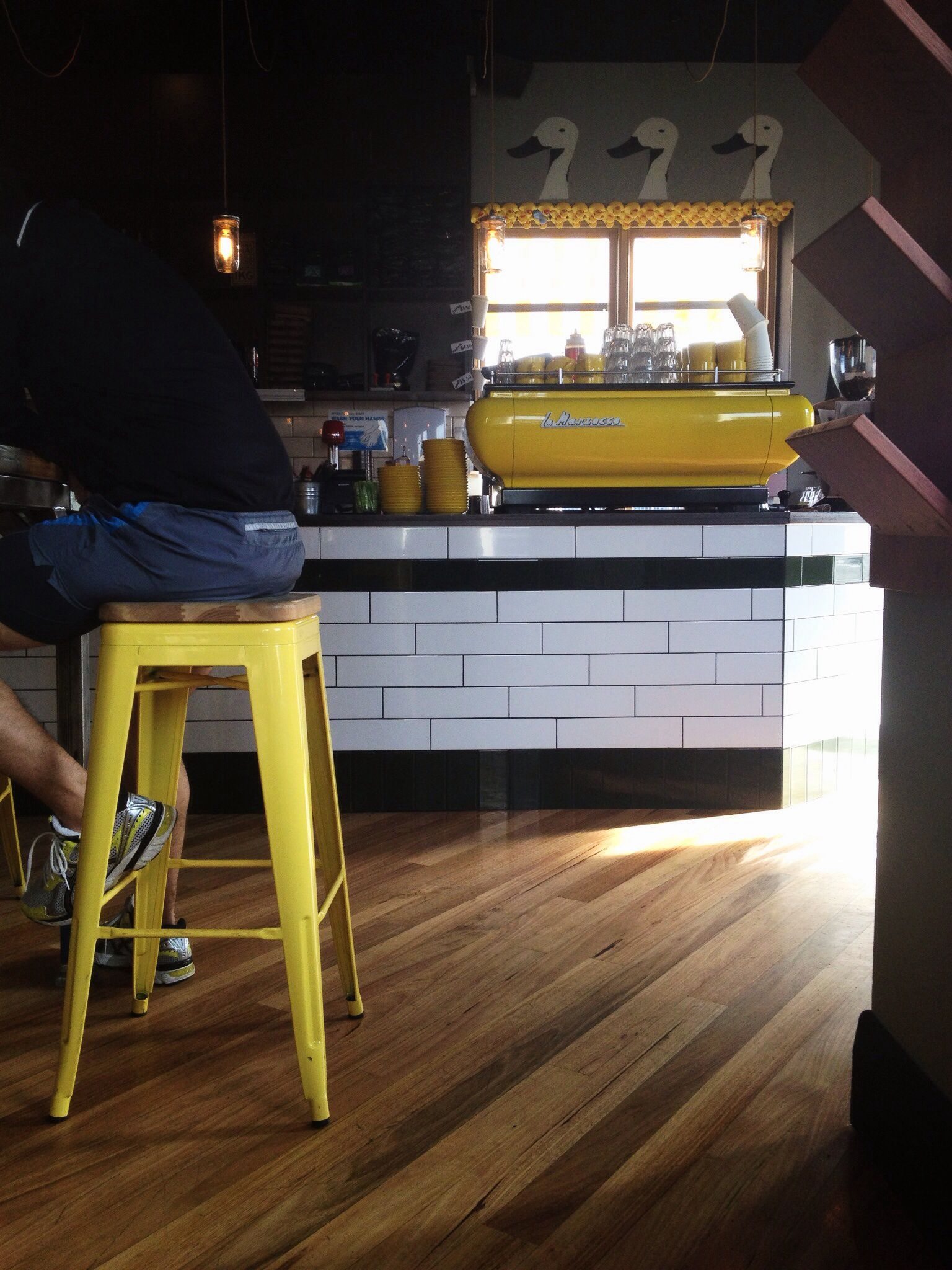 rubber duck cafe in clifton hill. yellow coffee machine, yellow
