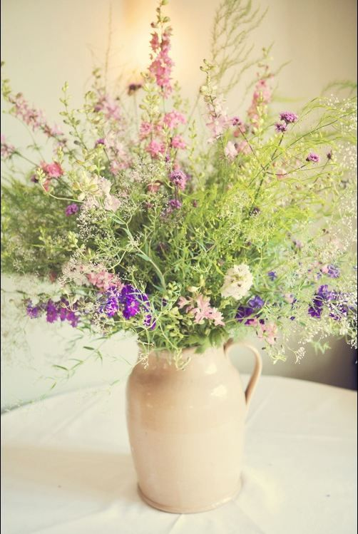 Gorgeous arrangement - wild flowers and larkspurs. photo by Lisa Devlin, flowers by Real Cut Flower Garden Company