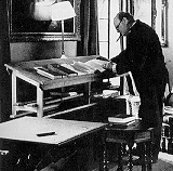 Winston Churchill at his sweet stand up desk.