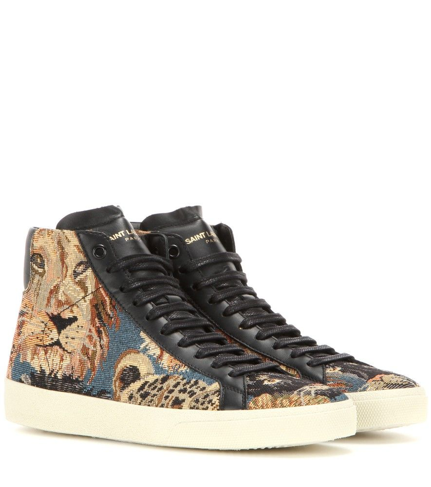 Saint Laurent - Canvas high-top sneakers - Saint Laurent crafts a vintage-inspired design with these high-top sneakers. Trimmed with smooth black leather to complement the laces, the pair is crafted in a tapestry-reminiscent canvas with an ornate lion motif. Note the discreetly embossed logo to the heel for recognition points. seen @ www.mytheresa.com
