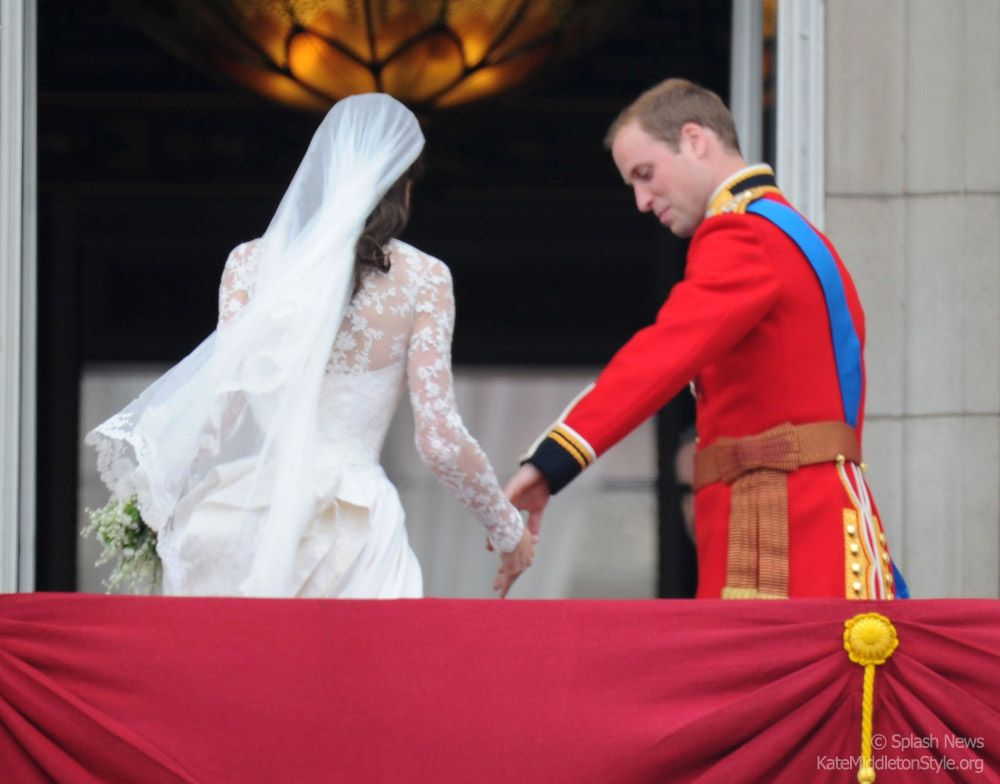 Looking back: As the newlywed couple embark on married life together, they turn from balcony to go indoors. Kate's veil sweeps in the wind as William takes her hand.