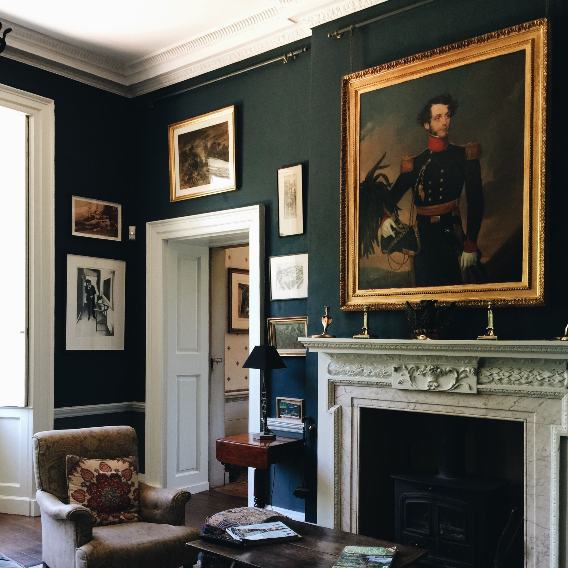 lovely dark green living room wall | Love the rich dark wall colour, which contrasted ...