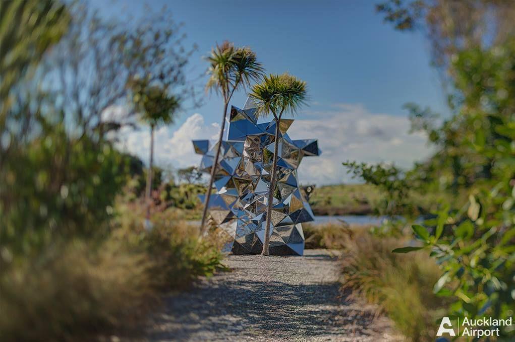Sculpture trail behind butterfly creek