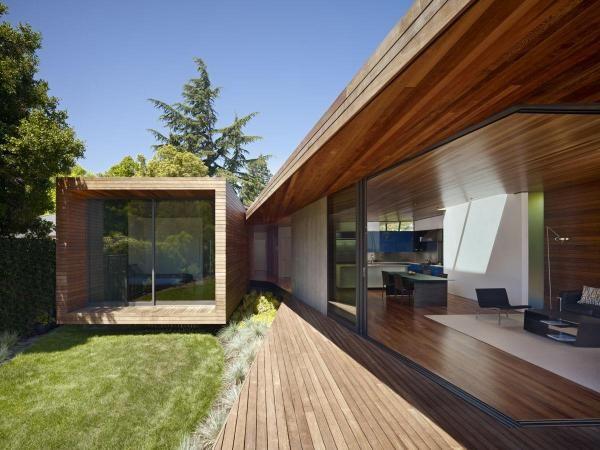 современный одноэтажный дом из бруса фото
