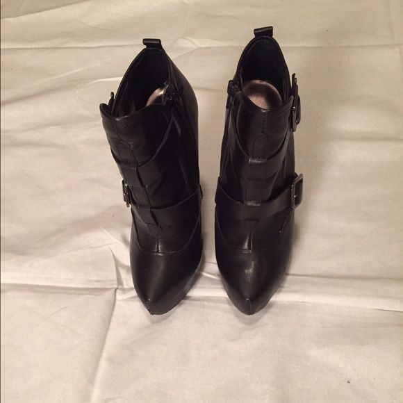Black ankle boots by Bakers Black ankle boots with 5 inch heel. Boots have a side zipper and 1 inch platform. Leather upper balance man made. Size 6.5 Bakers Shoes Ankle Boots & Booties